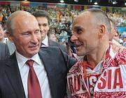 Il campione bresciano Gamba con il presidente Putin (foto Epa)